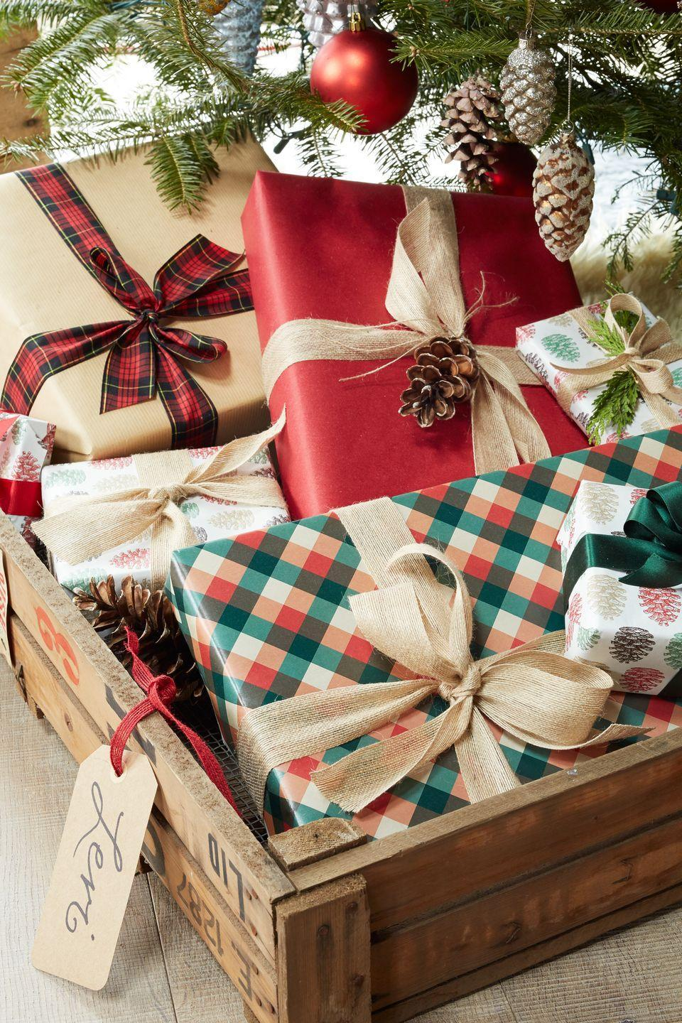 """<p>Swap out stockings for vintage crates! Give each guest a special delivery on Christmas morning by corralling gifts in tagged shipping crates under the tree.</p><p><a class=""""link rapid-noclick-resp"""" href=""""https://go.redirectingat.com?id=74968X1596630&url=https%3A%2F%2Fwww.etsy.com%2Fmarket%2Fwooden_crates&sref=https%3A%2F%2Fwww.countryliving.com%2Fhome-design%2Fdecorating-ideas%2Fadvice%2Fg1247%2Fholiday-decorating-1208%2F"""" rel=""""nofollow noopener"""" target=""""_blank"""" data-ylk=""""slk:SHOP WOODEN CRATES"""">SHOP WOODEN CRATES</a><br></p>"""
