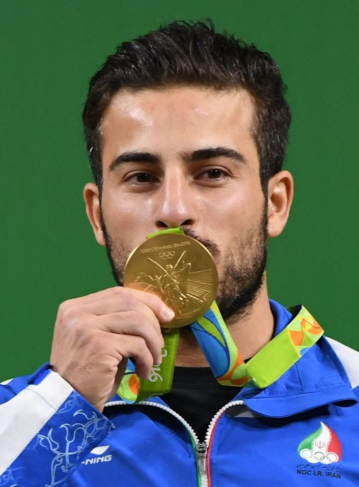 Iranian weightlifter Kianoush Rostami won gold at the Summer Olympics in Rio last year. (Photo: GOH CHAI HIN via Getty Images)