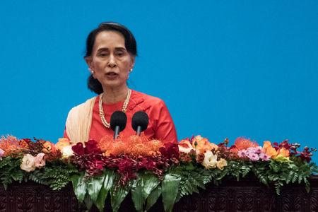 """Myanmar's State Counsellor Aung San Suu Kyi gives a speech at the opening ceremony of the """"CPC in dialogue with world political parties high-level meeting, at the Great Hall of the People in Beijing, China December 1, 2017. REUTERS/Fred Dufour/Pool/Files"""