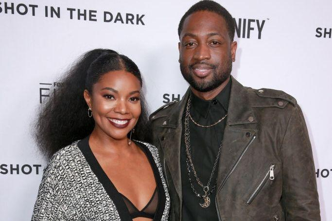 """The Miami Heat star couldn't be with his son at the march, but wife Gabrielle Union was. Wade wrote on Instagram, """"We support each other with pride!"""""""