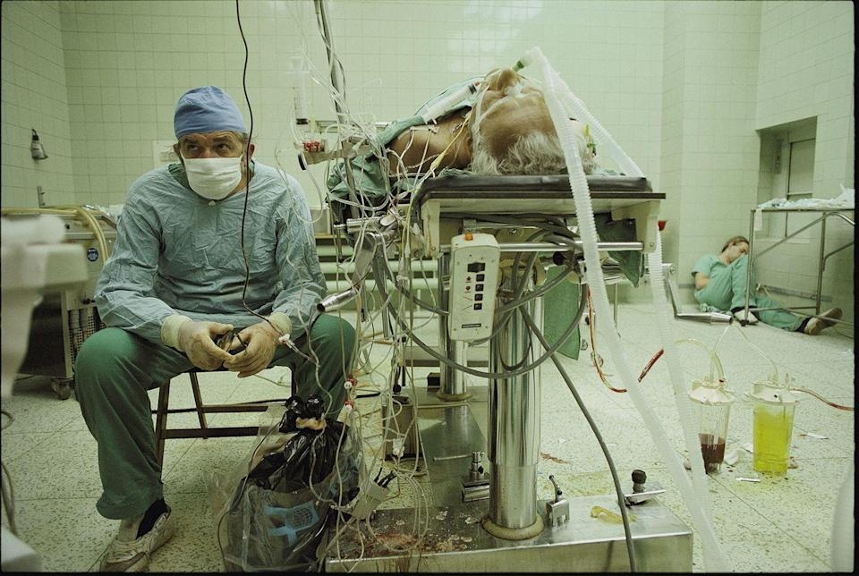 <p>1987. Zbigniew Religa, watching his patient, Tadeusz Zitkevits's, vital signs, after a 23-hour heart transplant. His colleague is asleep in the corner.</p>