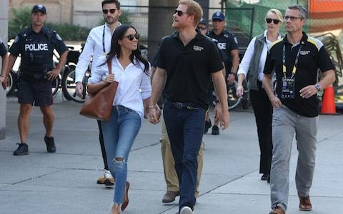 Prince Harry and Meghan Markle attend the Tennis together at the Invictus Games in Toronto - Credit: Splash