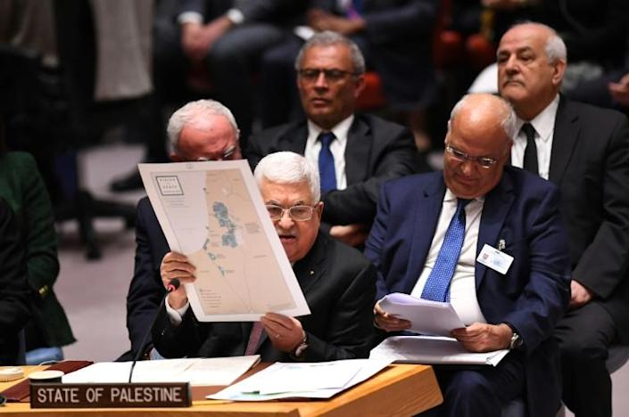 Palestinian president Mahmud Abbas holds up a map as he urges the UN Security Council to reject US President Donald Trump's Middle East plan (AFP Photo/Johannes EISELE)