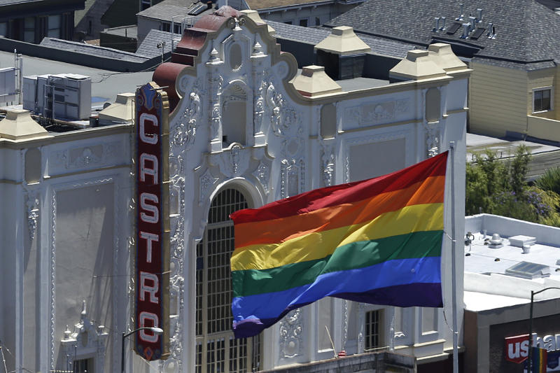 A rainbow flag flies in front of the Castro Theater in San Francisco, Wednesday, June 26, 2013. In a major victory for gay rights, the Supreme Court on Wednesday struck down a provision of a federal law denying federal benefits to married gay couples and cleared the way for the resumption of same-sex marriage in California. (AP Photo/Jeff Chiu)