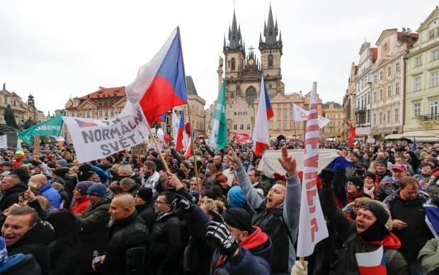 Thousands of demonstrators take part in a protest against the government's restrictive measures to curb the spread of COVID-19, in the capital of Prague on Jan. 10.