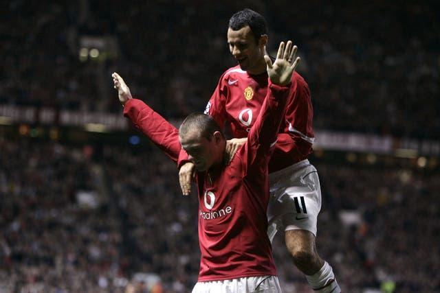 Ryan Giggs jumps on Wayne Rooney's back after his hat-trick goal