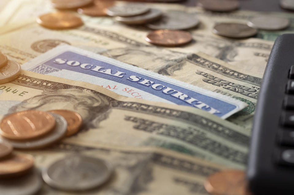 Social security and medicare concept with social security card and pile of money.