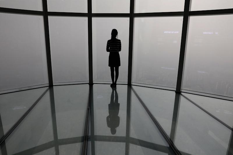A South Korean woman looks at a view of Seoul city shrouded by fine dust during a polluted day on March 6, 2019 in Seoul, South Korea. Most of South Korea was blanketed by extraordinarily heavy levels of choking fine dust air pollution for the sixth consecutive day and forecasters say the condition is unlikely to improve for the time being. (Photo: Chung Sung-Jun/Getty Images)