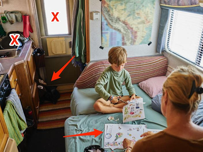 Mother and son cutting out pictures in camper van X's and arrows over 4 spots that are cluttered and stressful
