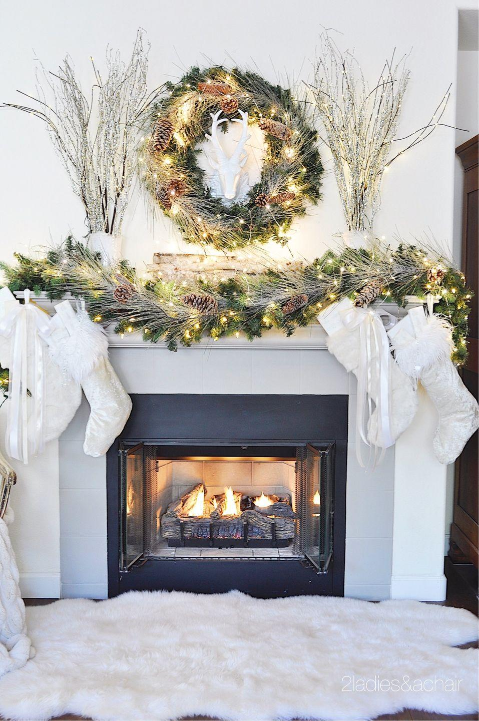 "<p>Make a real statement with a lit garland so big that you can't even see your mantel anymore. Complete the look with a matching wreath and equally large branches. </p><p><em>See more at <a href=""https://2ladiesandachair.com/blog/2017/11/26/christmas-home-decorating-ideas-for-a-beautiful-holiday"" rel=""nofollow noopener"" target=""_blank"" data-ylk=""slk:2 Ladies and a Chair"" class=""link rapid-noclick-resp"">2 Ladies and a Chair</a>.</em></p><p><a class=""link rapid-noclick-resp"" href=""https://www.amazon.com/Pursuestar-Lifelike-Branches-Artificial-Decoration/dp/B07TLXSW2C/?tag=syn-yahoo-20&ascsubtag=%5Bartid%7C10072.g.34484299%5Bsrc%7Cyahoo-us"" rel=""nofollow noopener"" target=""_blank"" data-ylk=""slk:SHOP WILLOW BRANCHES"">SHOP WILLOW BRANCHES</a></p>"