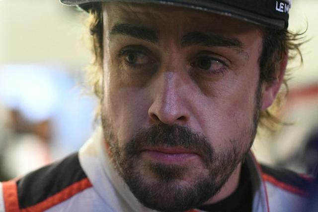 Fernando Alonso spent the final hours of Le Mans as a spectator after a series of punishing stints at the wheel (AFP Photo/Jean-Francois MONIER)