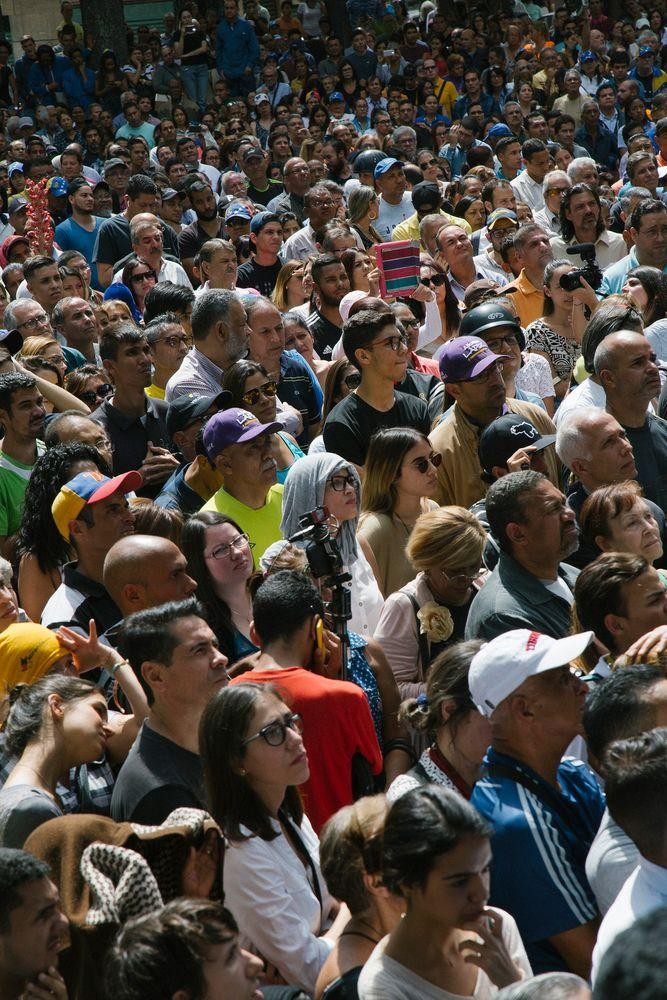 A crowd gathers to listen to opposition leader Juan Guaidó during a news conference on Jan. 25, 2019.