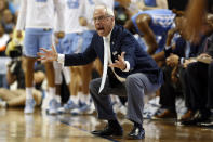FILE - North Carolina head coach Roy Williams reacts during the second half of an NCAA college basketball game against Virginia Tech at the Atlantic Coast Conference tournament in Greensboro, N.C., in this Tuesday, March 10, 2020, file photo. North Carolina announced Thursday, April 1, 2021, that Hall of Fame basketball coach Roy Williams is retiring after a 33-year career that includes three national championships. (AP Photo/Ben McKeown, File)
