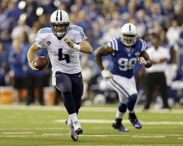 Tennessee Titans' Ryan Fitzpatrick (4) runs during the first half of an NFL football game against the Indianapolis Colts on Sunday, Dec. 1, 2013, in Indianapolis. (AP Photo/Michael Conroy)