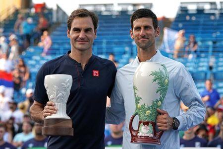 Aug 19, 2018; Mason, OH, USA; Roger Federer (left) and Novak Djokovic (right) pose for photos after the finals in the Western and Southern tennis open at Lindner Family Tennis Center. Mandatory Credit: Aaron Doster-USA TODAY Sports