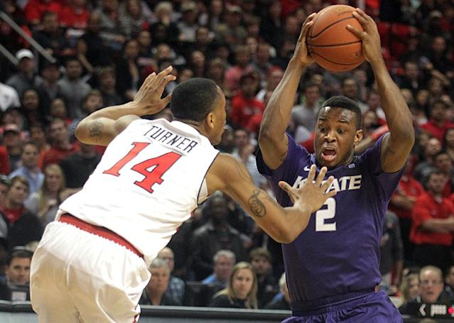 Texas Tech's Robert Turner (14) defends Kansas State's Marcus Foster (2) during an NCAA college basketball game in Lubbock, Texas, Tuesday, Feb, 25, 2014. (AP Photo/Lubbock Avalanche-Journal, Stephen Spillman)