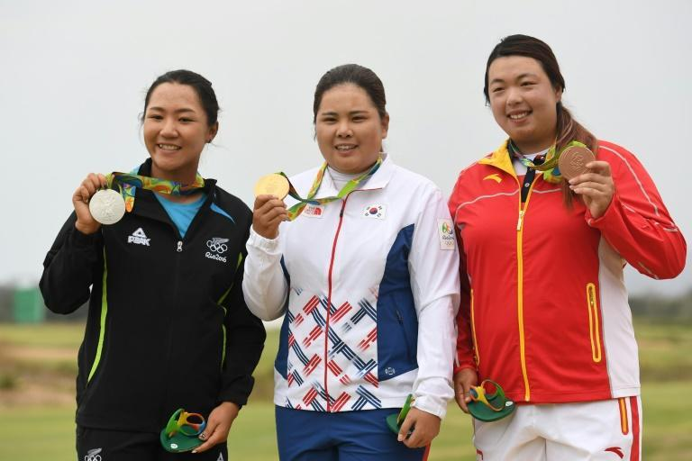 Park In-bee (centre) with her gold medal after the Rio 2016 Olympics golf tournament alongside silver medallist Lydia Ko from New Zaleand and Feng Shanshan of China who took the bronze