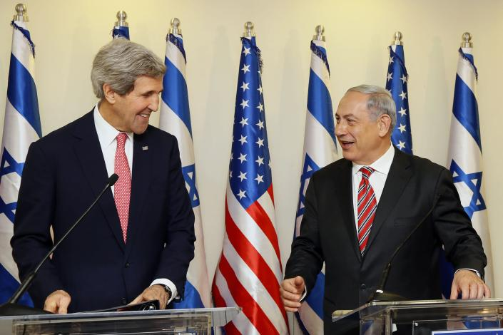 U.S. Secretary of State John Kerry shares a laugh with Israeli Prime Minister Benjamin Netanyahu (R) during a news conference following a meeting at Netanyahu's office in Jerusalem December 5, 2013. Kerry said on Thursday that some progress had been made in Israeli-Palestinian peace talks and that he had presented Israel with ideas for improving its security under any future accord. REUTERS/Gali Tibbon/Pool (JERUSALEM - Tags: POLITICS)