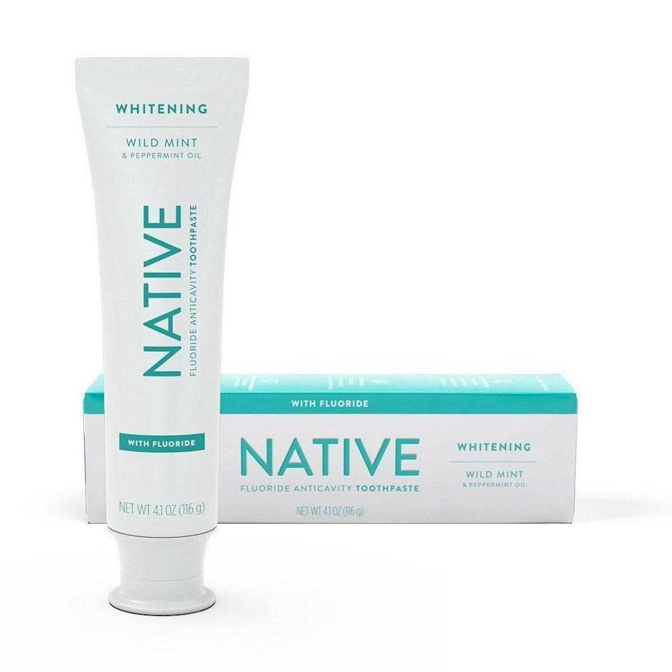"""Powered by wild mint and peppermint oil, Native's restorative Whitening Toothpaste teams up 0.243 percent sodium fluoride and hydrated silica (an abrasive used to polish teeth and clear buildup) for effective stain removal, while glycerin keeps your mouth retain its natural moisture and xylitol banishes cavity-causing bacteria. For sensitive teeth, Native also offers a <a href=""""https://goto.target.com/q5QKj"""" rel=""""nofollow noopener"""" target=""""_blank"""" data-ylk=""""slk:fluoride-free version"""" class=""""link rapid-noclick-resp"""">fluoride-free version</a> that relies on silica to whiten."""