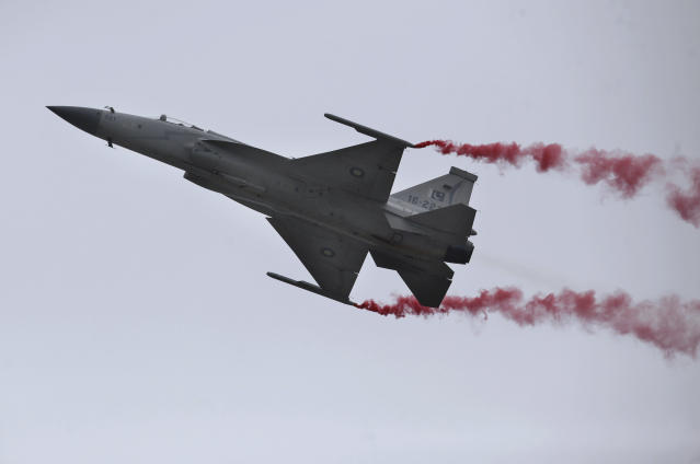 A Pakistani Air Force JF-17 fighter jet flies during a military parade to mark Pakistan National Day, in Islamabad, Pakistan, Saturday, March 23, 2019. Pakistanis are celebrating their National Day with a military parade that's showcasing short- and long-range missiles, tanks, jets, drones and other hardware. (AP Photo/Anjum Naveed)
