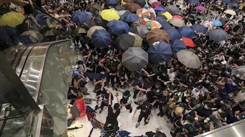 There was chaos in the New Town Plaza on July 14 last year as protesters and police clashed. Photo: Felix Wong
