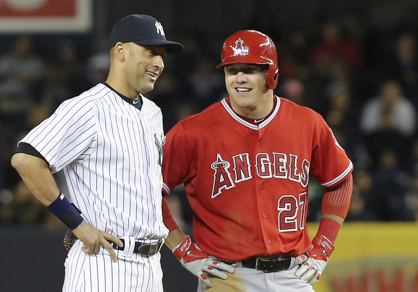 Mike Trout (right) and Derek Jeter shared an awkward first meeting thanks to Trout's oddly-timed autograph request. (AP)