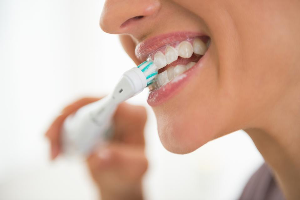 'Simple daily steps to maintain oral hygiene' could be 'life-saving' amid the pandemic, a scientist has said. (Stock, Getty Images)