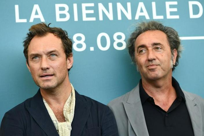 "Born-again: British actor Jude Law (left) who plays the ""ressurected"" pontiff in ""The New Pope"" with Paolo Sorrentino at the Venice film festival in September (AFP Photo/Vincenzo PINTO )"