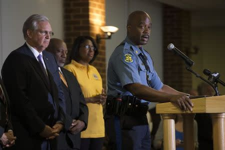 Highway Patrol Captain Ron Johnson speaks, as Missouri Governor Jay Nixon (L) watches, during a news conference at University of Missouri-St. Louis in St. Louis, Missouri August 14, 2014. REUTERS/Mario Anzuoni