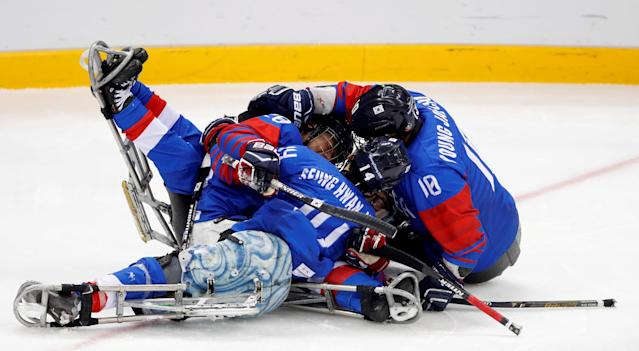 Ice Hockey - Pyeongchang 2018 Winter Paralympics - Bronze Medal Game - South Korea v Italy - Gangneung Hockey Centre, Gangneung, South Korea - March 17, 2018 - Jang Dong-shin of South Korea celebrates with teammates after scoring a goal. REUTERS/Carl Recine TPX IMAGES OF THE DAY