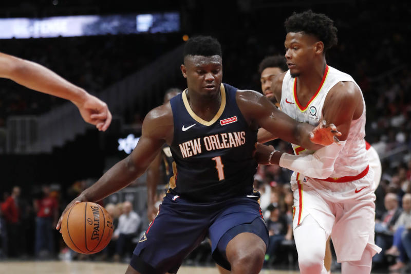 New Orleans Pelicans forward Zion Williamson (1) drives against Atlanta Hawks forward Cam Reddish (22) during the second half of a preseason NBA basketball game Monday, Oct. 7, 2019, in Atlanta. (AP Photo/John Bazemore)