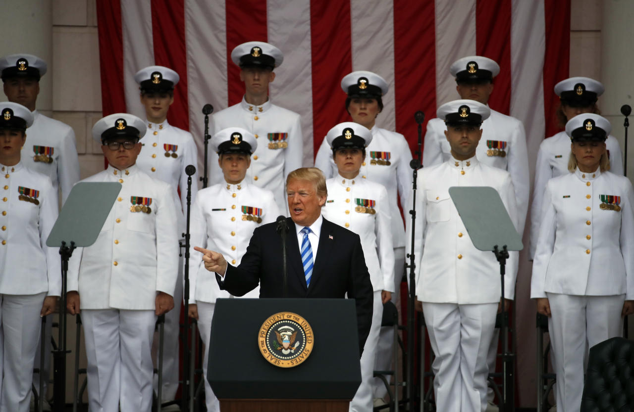 <p>President Donald Trump pauses at the podium as he arrives for a ceremony at the Memorial Amphitheater in Arlington National Cemetery on Memorial Day, Monday, May 28, 2018, in Arlington, Va.(Photo: Alex Brandon/AP) </p>