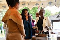 <p>Along with her mother Doria Ragland, Meghan appears to be making a point or playfully wagging her finger as she launches her cookbook. The recipes weren't just royally inspired, though — they were created by a group of women affected by the Grenfell Tower fire.<br></p>
