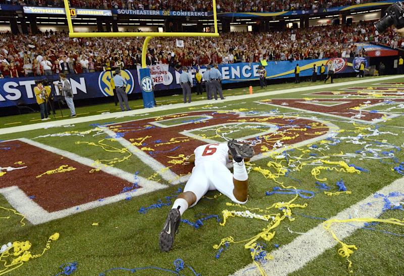 Alabama running back Blake Sims (6) celebrates after their 32-28 win in the Southeastern Conference championship NCAA college footballgame against Georgia, Saturday, Dec. 1, 2012, in Atlanta. (AP Photo/Atlanta Journal-Constitution, Hyosub Shin) MARIETTA DAILY OUT; GWINNETT DAILY POST OUT; LOCAL TV OUT; WXIA-TV OUT; WGCL-TV OUT