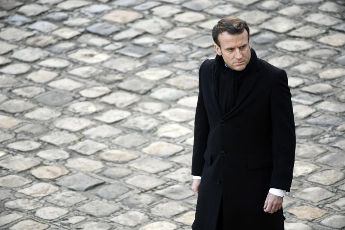 French President Emmanuel Macron attends an award ceremony at the Invalides Monument, Monday Dec. 9, 2019 in Paris. (Ludovic Marin/Pool via AP)
