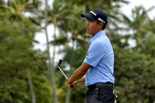 Collin Morikawa reacts to missing his birdie putt on the 10th green during the third round of the Sony Open PGA Tour golf event, Saturday, Jan. 11, 2020, at Waialae Country Club in Honolulu. (AP Photo/Matt York)