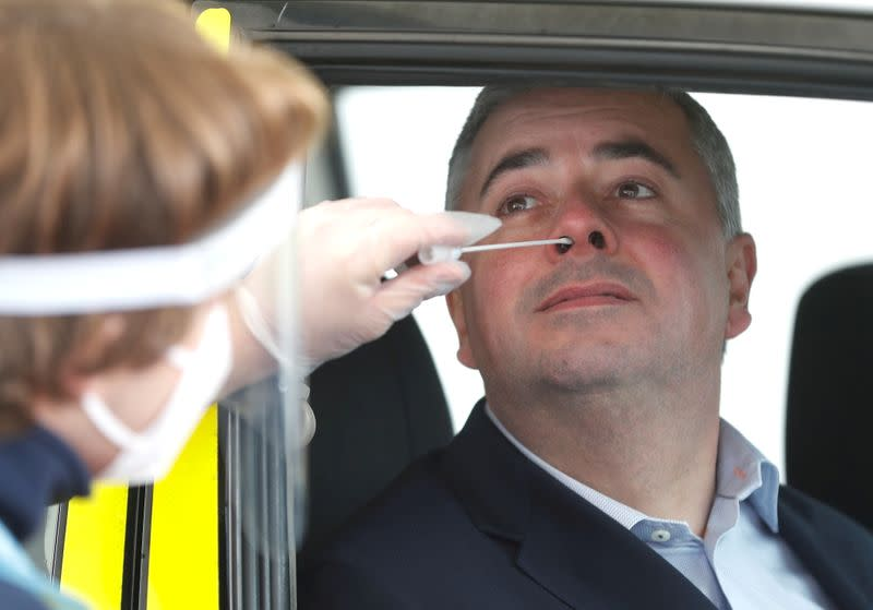 CEO of Gatwick Airport Stewart Wingate takes a COVID-19 test at the Express Test testing facility at Gatwick airport, amid the coronavirus disease (COVID-19) outbreak, in Crawley