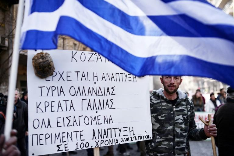 Greece's economy shrank 0.4% in the fourth quarter but remains 0.3% larger year-on-year