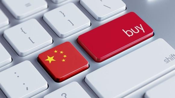 """Two buttons on a keyboard, one with a Chinese flag and another labeled """"buy."""""""