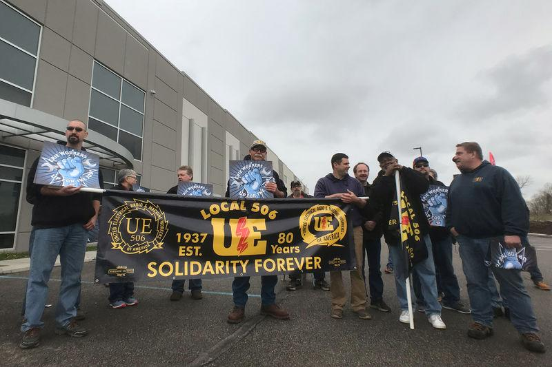 Union members protest outside General Electric's annual meeting in Imperial Pennsylvania