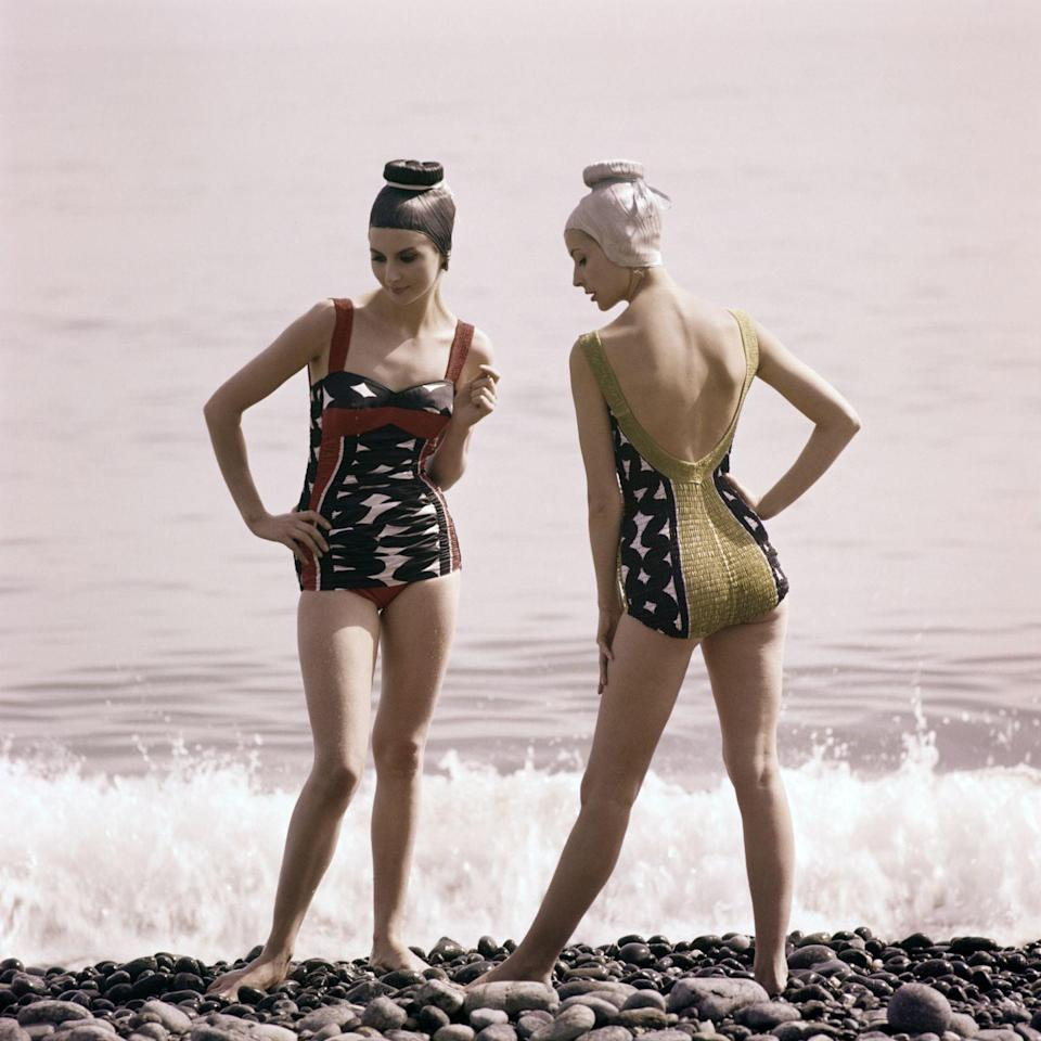 <p>Just me, or do these two look like they're spilling major tea?? Also, talk to me about those swim caps.</p>