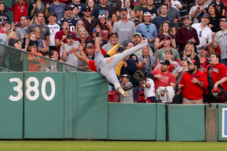 Sep 29, 2019; Boston, MA, USA; Baltimore Orioles center fielder Stevie Wilkerson (12) robs Boston Red Sox center fielder Jackie Bradley (not pictured) of a home run during the eighth inning against the Boston Red Sox at Fenway Park. Mandatory Credit: Paul Rutherford-USA TODAY Sports     TPX IMAGES OF THE DAY