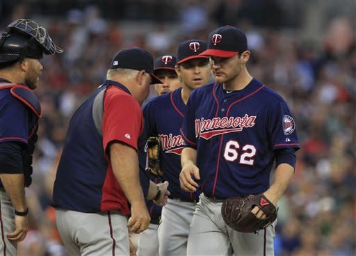Minnesota Twins starting pitcher Liam Hendriks is pulled by manager Ron Gardenhire during the fifth inning of a baseball game against the Detroit Tigers in Detroit, Monday, July 2, 2012. (AP Photo/Carlos Osorio)