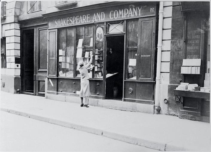 Sylvia Beach, founder and owner of the Shakespeare & Company bookstore in Paris decorates the store's window. Beach's bookstore became an important part of the Paris literary scene from 1919 to 1941.