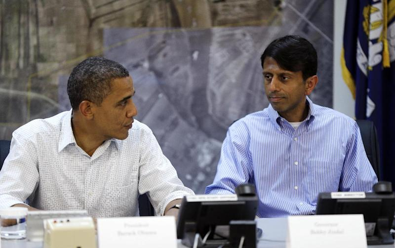 President Barack Obama, left, and Gov. Bobby Jindal, right, and other local official during a briefing at Saint John Parish Emergency Operations Center (EOC) in LaPlace, La., in Saint John the Baptist Parish, Monday, Sept. 3, 2012. Obama traveled to the region to view the ongoing response and recovery efforts to Hurricane Isaac. (AP Photo/Pablo Martinez Monsivais)