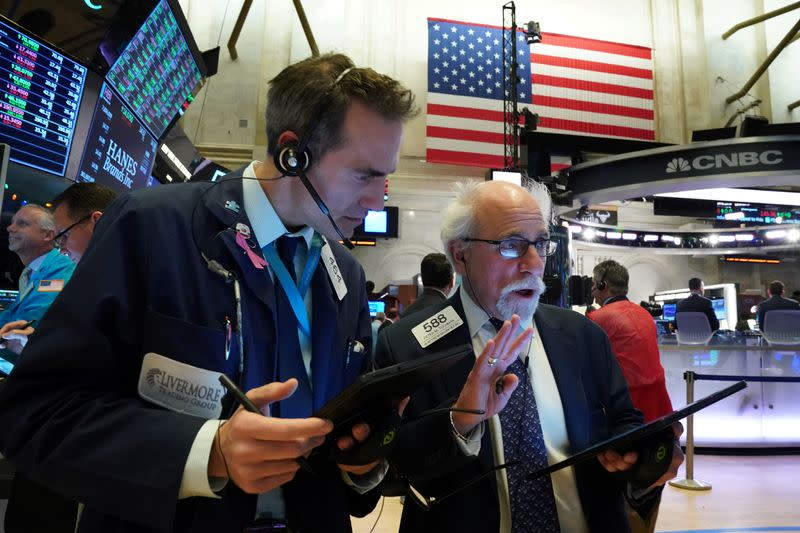 FILE PHOTO:  Traders work at the New York Stock Exchange
