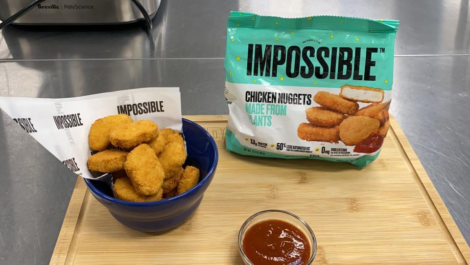 This Sept. 21, 2021 photo shows Impossible Foods' new meatless nuggets in Redwood City, Calif. The nuggets are now available at some restaurants and will be sold in grocery stores nationwide later this year. (AP Photo/Terry Chea)