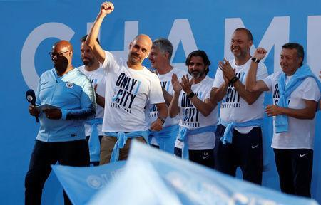 Manchester City manager Pep Guardiola on stage during the parade. Reuters/Andrew Boyers