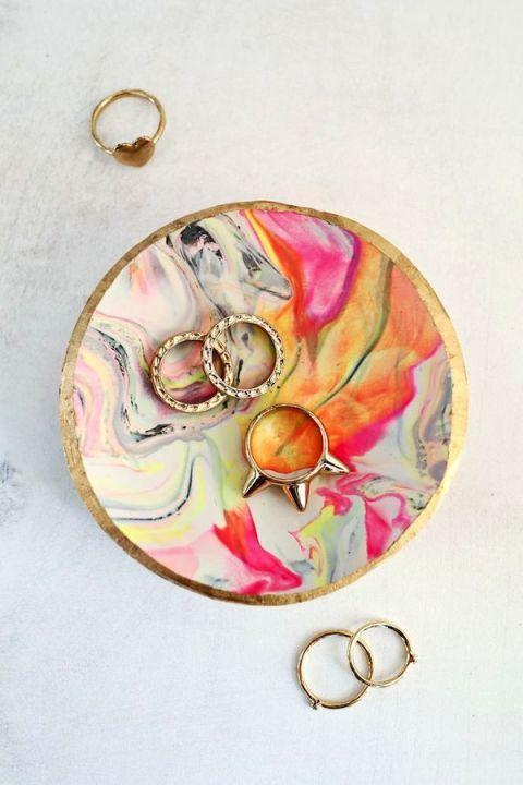 """<p>Top tip: Adding a cute Mother's Day quote on a gift tag would make this dish extra special. </p><p><em><a href=""""http://www.abeautifulmess.com/2014/11/marbled-clay-ring-dish.html"""" rel=""""nofollow noopener"""" target=""""_blank"""" data-ylk=""""slk:Get the tutorial at A Beautiful Mess »"""" class=""""link rapid-noclick-resp"""">Get the tutorial at A Beautiful Mess »</a></em> </p>"""
