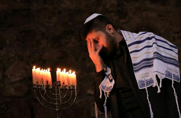 The lighting of candles during Hanukkah commemorates the rededication of the Temple in Jerusalem in 164 BC (AFP Photo/SAFIN HAMED)
